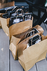Brown paper shopping bags full of decorations