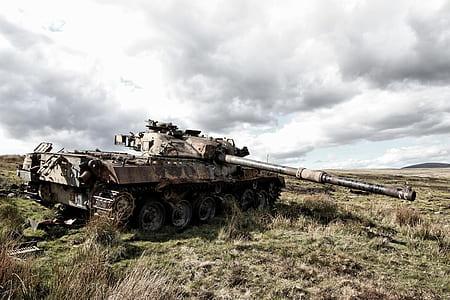 brown battle tank on mountain