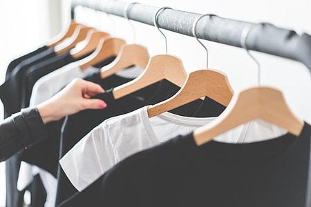 Woman Choosing T-Shirts During Clothing Shopping at Apparel Store #2