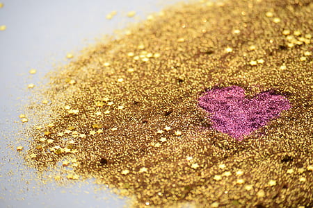 gold and pink glitter scattered on the floor