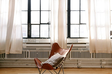 white and gray chair near glass windows