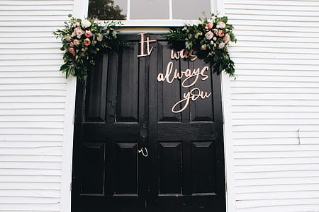 black wooden double doors with it was always you decor