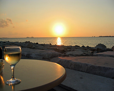 clear wine glass on table during sunset