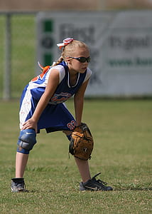 Girl Holding Brown Leather Baseball Mitt