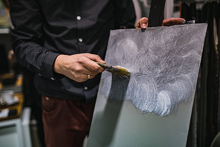 People painting on canvas