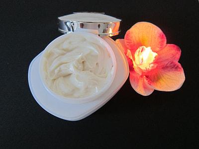 cream beside orchid flower