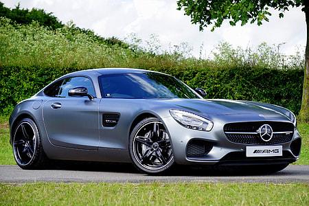silver Mercedes AMG GT beside green grass