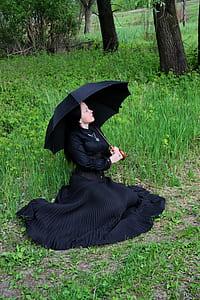 woman wearing dress holding umbrella