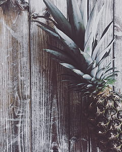 photo of pineapple on brown wooden table