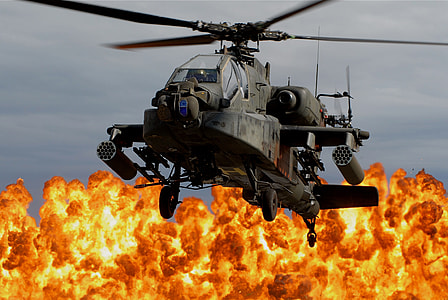 gray apache helicopter with blazing fire background