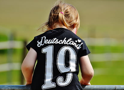 Girl Wearing Deutschland 19 Black T Shirt during Daytime