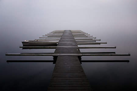 brown wooden dock on large body of water