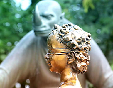 close-up photo of girl with eye mask statue
