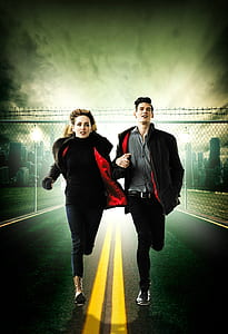 man and woman in black and red jacket running