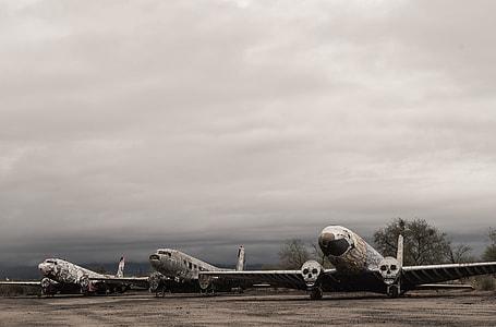 three white passenger planes under gray sky during daytime