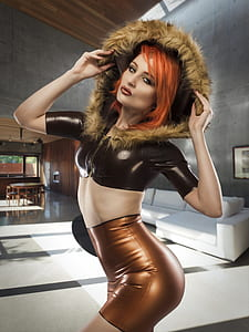 woman wearing black parka crop top and copper skirt