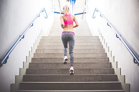 Young Fitness Girl Running Up The Stairs