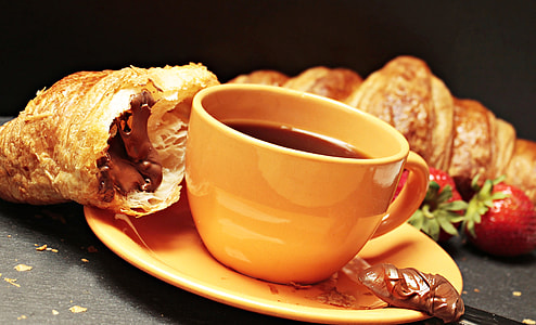 brown ceramic coffee mug
