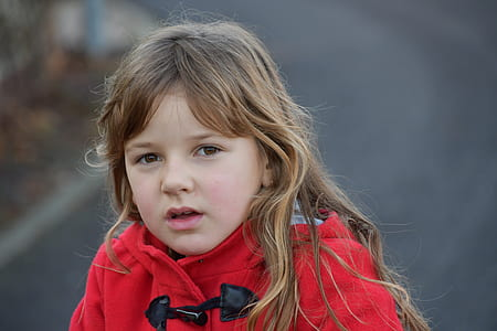 Blonde Girl Wearing Red Toggle Jacket