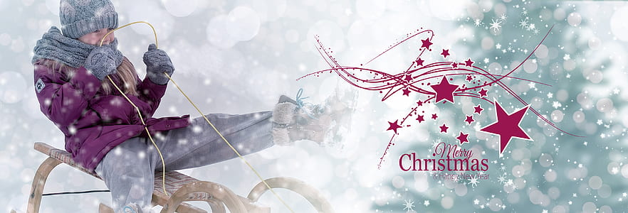 boy riding sled with Merry Christmas text overlay