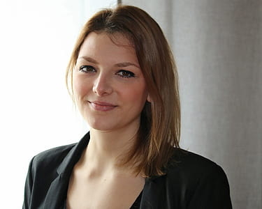 woman wearing black blazer and black scoop-neck top