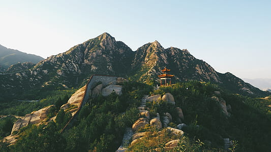 pagoda on mountain range photograph