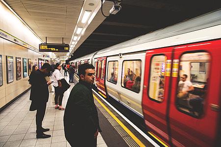 People waiting on the train platform on the London Underground