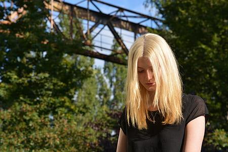blonde-haired woman wearing black shirt facing down