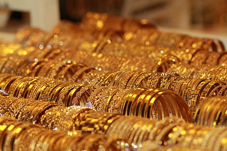 photography of gold-colored bracelet lot
