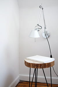 book on brown wooden table near wall
