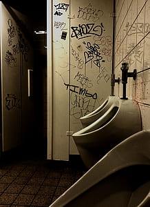 typographic vandals on bathroom walls