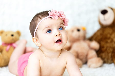 baby wearing pink floral headband