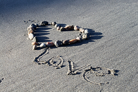 love text on gray sand
