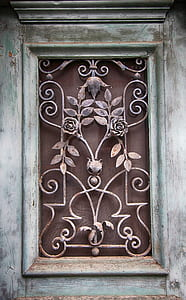 closeup photo of brown and gray floral grille
