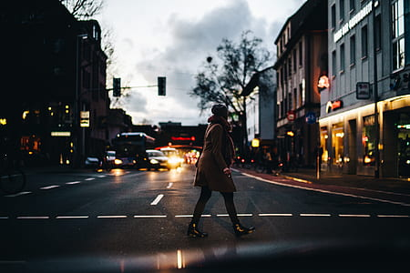 person walking on street during nighttime