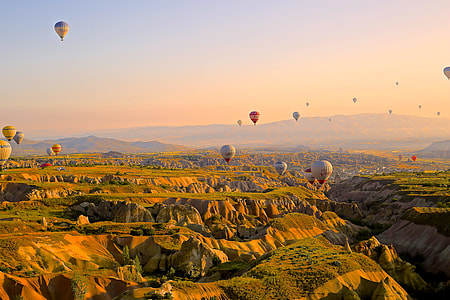 aerial view of hot air balloons on the sky during day time