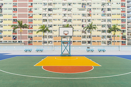 basketball field beside concrete building during daytime