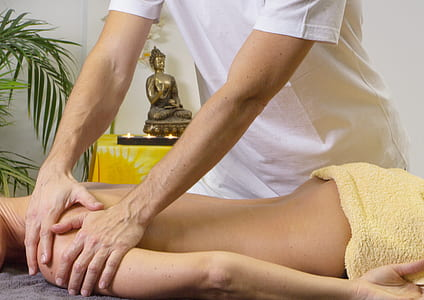 person massaging woman