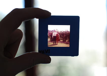person holding photo frame