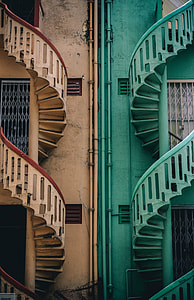 photo of brown and teal twirl stairs