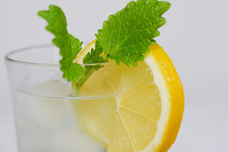 clear drinking glass with lemon fruit