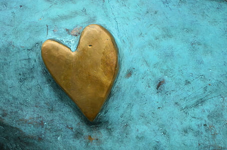 brown heart logo on teal board