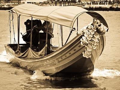 beige and black boat photo