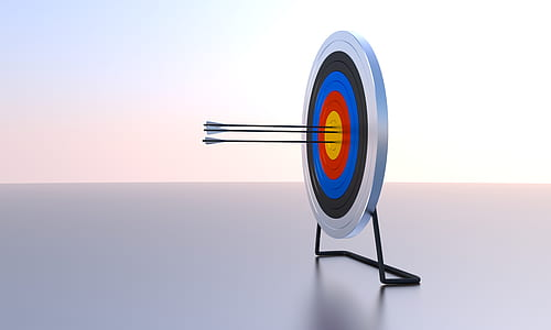 gray, blue, and red dartboard with three arrows