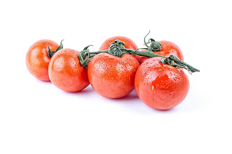 five red cherry tomatoes