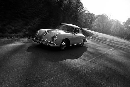 grayscale photo of classica car on road