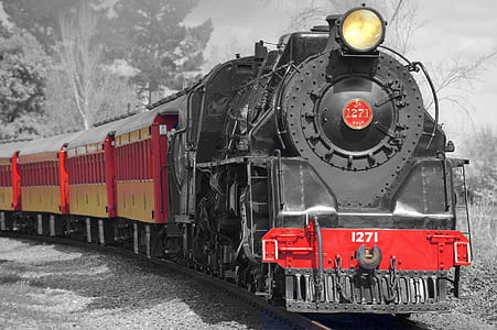 selective color photography of black and red train