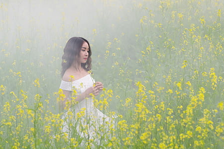 woman surrounded by yellow glowers