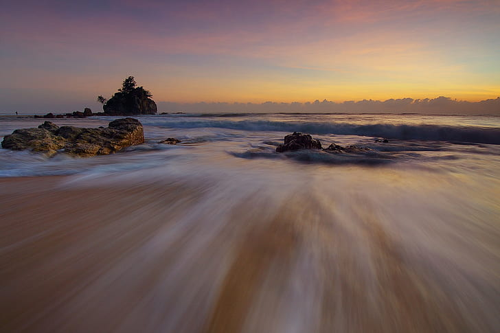timelapse photograph of low tide sea during golden hour