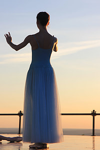 woman in blue spaghetti-strap dress during daytime